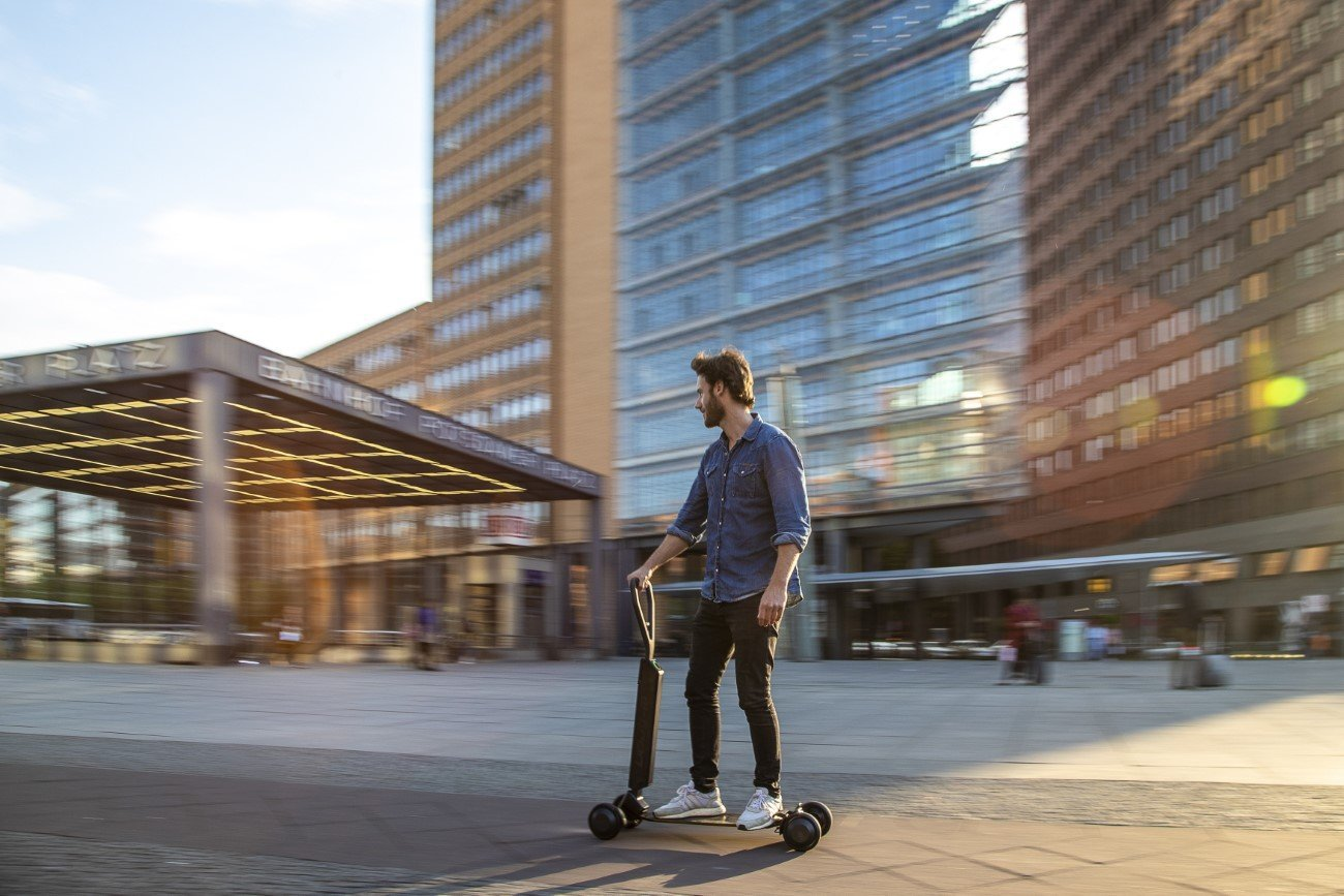 Audi combines e-scooter with skateboard