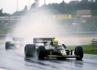 Ayrton Senna (BRA) Lotus 97T, dominated the race in appalling conditions to claim his first Grand Prix victory. Portuguese Grand Prix, Rd2, Estoril, Portugal, 21 April 1985. BEST IMAGE