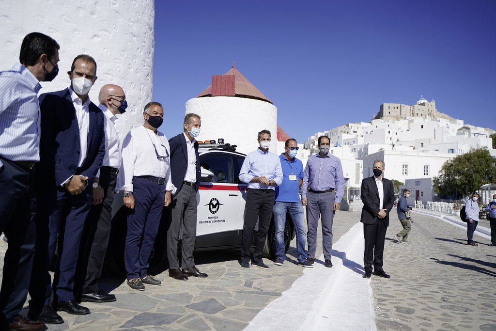 Astypalea: Kick-off for transformation to smart, sustainable isl Volkswagen CEO Herbert Diess and Prime Minister Kyriakos Mitsotakis handover Greece' first electric police car in Astypalea.